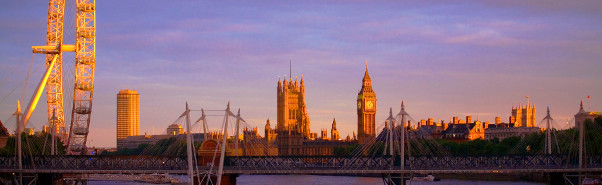 Early morning sunlight over the River Thames with the London Eye, Houses of Parliament and Hungerford Bridge